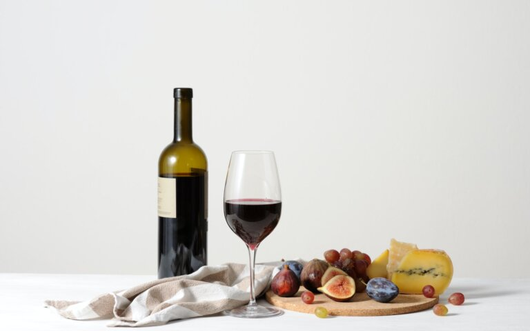 wine, cheese and fruits